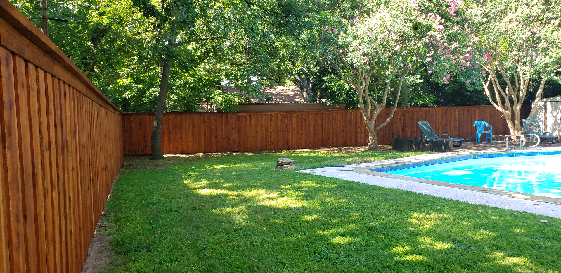 Board-on-Board wood fence stained ReadySeal Pecan